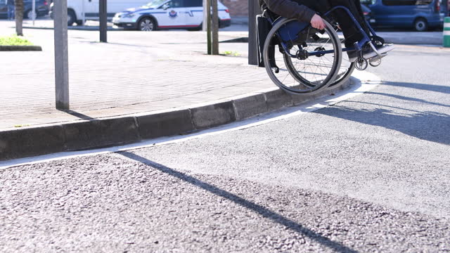 video of a disabled man climbing a curb on a sidewalk that is not accessible for his wheelchair. selective focus. - wheelchair stock videos & royalty-free footage