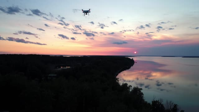 video of a drone flying over a wooded area - control stock videos & royalty-free footage