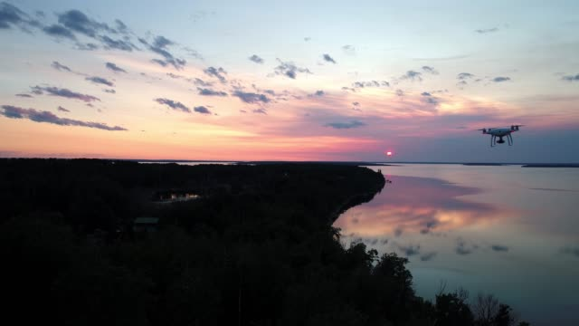 video of a drone flying over a wooded area - air vehicle stock videos & royalty-free footage