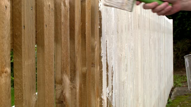 hd: video of a fence being painted - fence stock videos & royalty-free footage