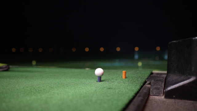 video of a golfer hitting the golf ball at night - hole stock videos & royalty-free footage