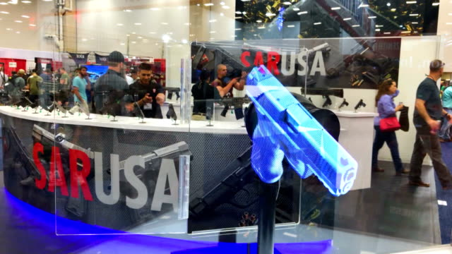 a 3d video of a handgun is displayed at the sar usa booth during nra annual meeting exhibits at the kay bailey hutchison convention center on may 5... - national rifle association stock videos & royalty-free footage