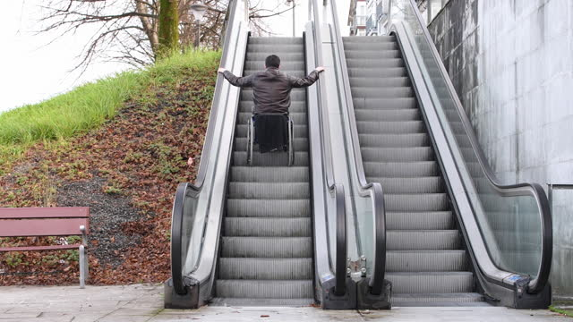 video of a handicapped man backwards down an escalator with his wheelchair. - young men stock videos & royalty-free footage