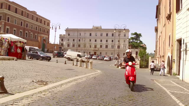 video of a man riding a red motorbike around the neighborhood of monti in rome, italy, at daytime - crash helmet stock videos & royalty-free footage