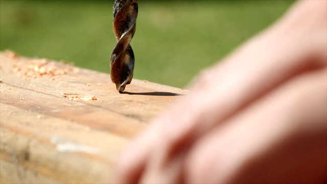 4k video of a person drilling a hole into wood - drill stock videos & royalty-free footage