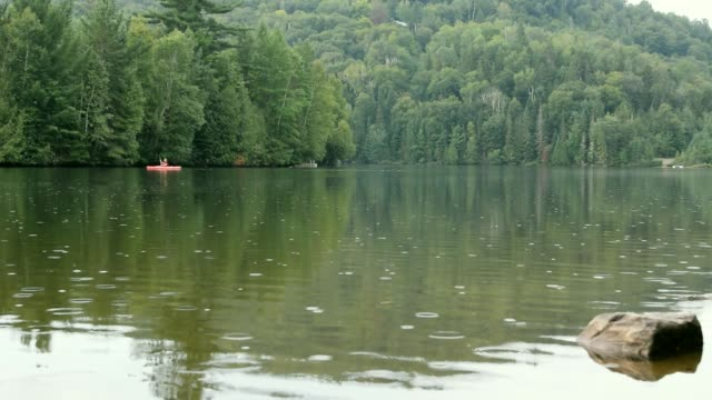 video of a portuguese woman kayaking on a lake. - camping stock videos & royalty-free footage