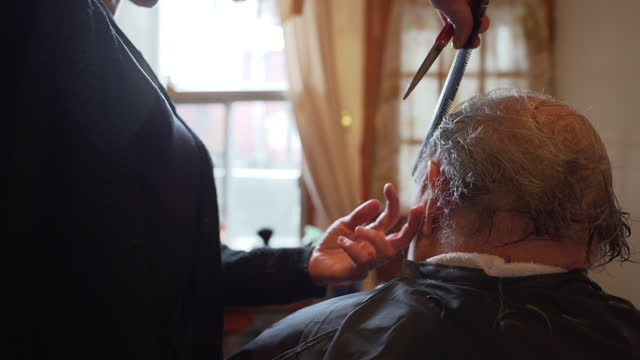 video of a senior man having a haircut. - care stock videos & royalty-free footage