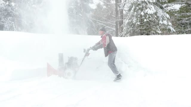 4k video of a senior man using snowblower after a snowstorm - traditionally canadian stock videos & royalty-free footage