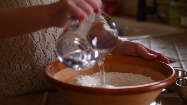 video of a woman cooking her bread. - simple living stock videos & royalty-free footage