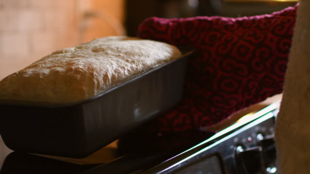 video of a woman cooking her bread. - baking stock videos & royalty-free footage