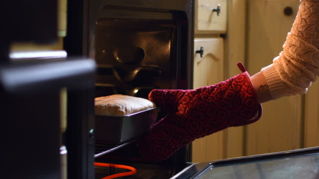 video of a woman cooking her bread. - comfort food stock videos & royalty-free footage