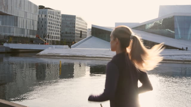 video of a woman exercising in early morning. - city life stock videos & royalty-free footage