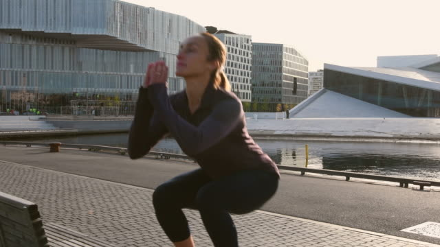 video of a woman exercising in early morning. - cardiovascular exercise stock videos & royalty-free footage