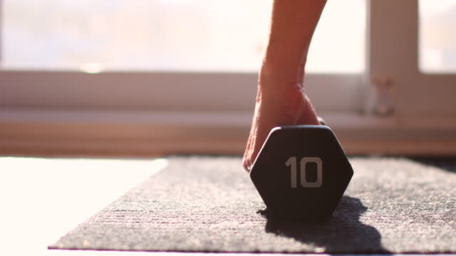 video of a woman training at home. - dumbbell stock videos & royalty-free footage