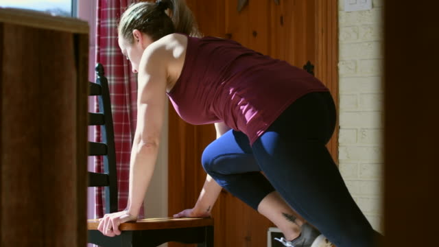 video of a woman training at home. - chair stock videos & royalty-free footage