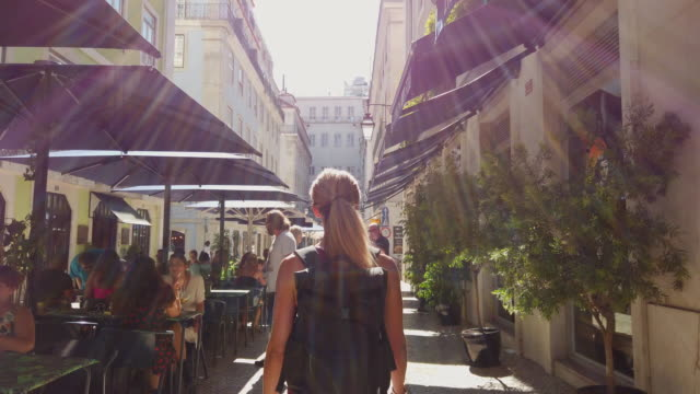 video of a woman visiting lisbon. - high street stock videos & royalty-free footage
