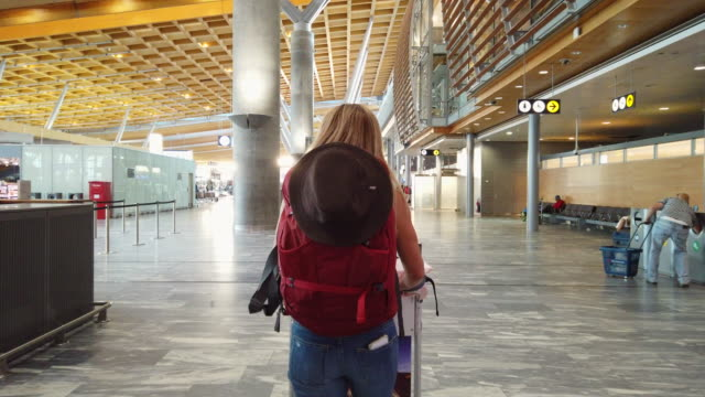 video of a woman walking in airport. - travel destinations stock videos & royalty-free footage