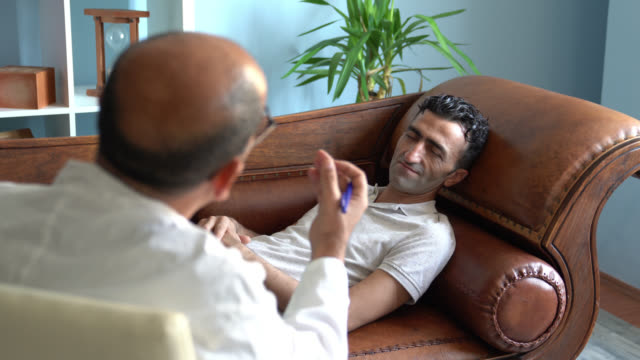 UHD Video Of Adult Man Lying On Psychiatrist Couch While having Therapy