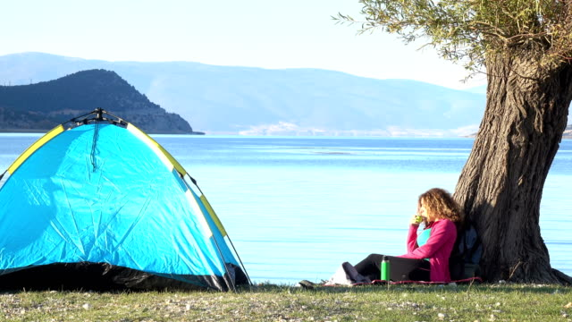 UHD Video Of Adult Woman Camping By Lake