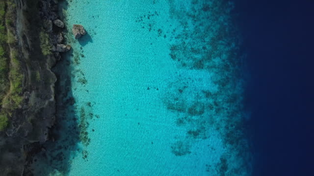 4k video of aerial view of caribbean sea in curacao - reef stock videos & royalty-free footage