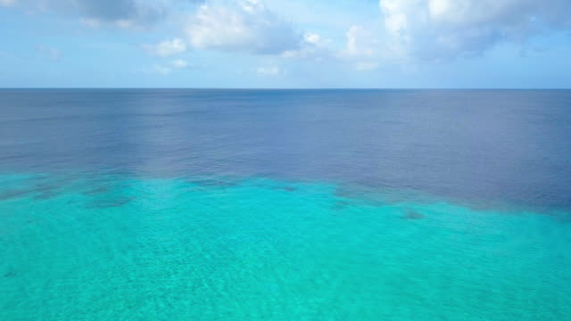 4k video of aerial view of caribbean sea in curacao - reef stock videos and b-roll footage