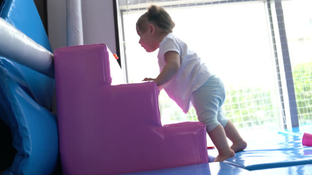 uhd video of baby girl crawling - selimaksan stock videos & royalty-free footage