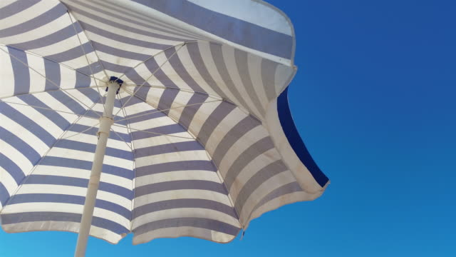 video of beach umbrella in 4k - beach umbrella stock videos and b-roll footage