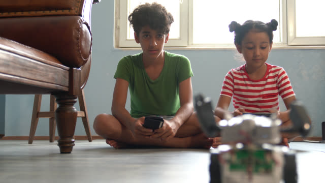 4k video of brother and sister playing with robotics - sister stock videos & royalty-free footage