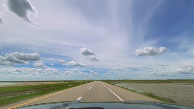 4k pov video of car driving on highway, saskatchewan, canada - prairie stock videos & royalty-free footage