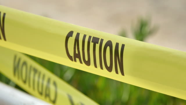 video of caution tape in 4k - safety stock videos & royalty-free footage