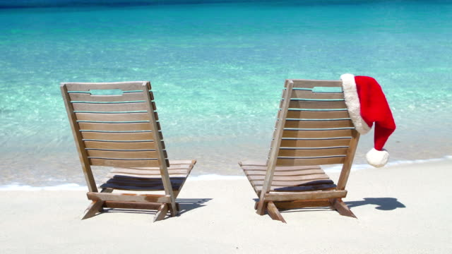 video of chairs with santa hats at a caribbean beach - st. john virgin islands stock videos & royalty-free footage
