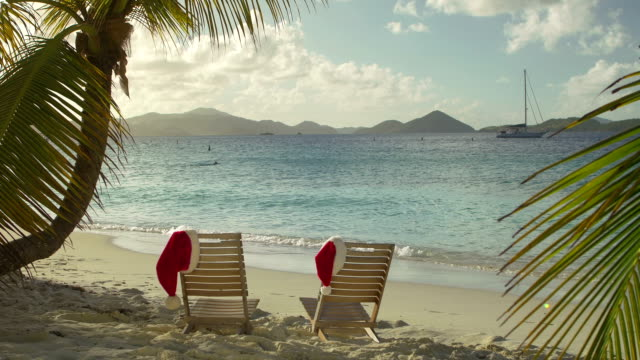 video of chairs with santa hats at a tropical beach - st. john virgin islands stock videos & royalty-free footage