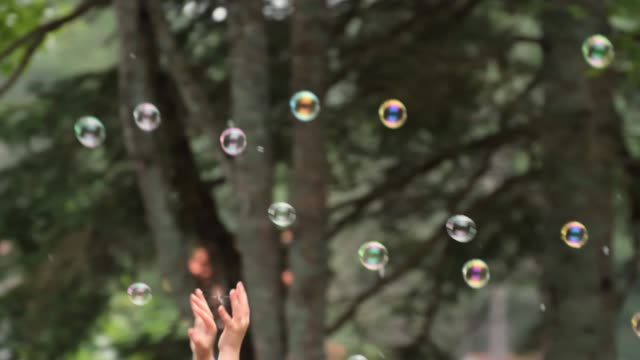 video of children trying to catch soap bubbles. - soap sud stock videos & royalty-free footage
