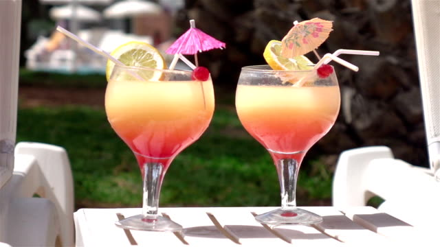 video of cocktails by the pool in real slow motion - tropical cocktail stock videos & royalty-free footage