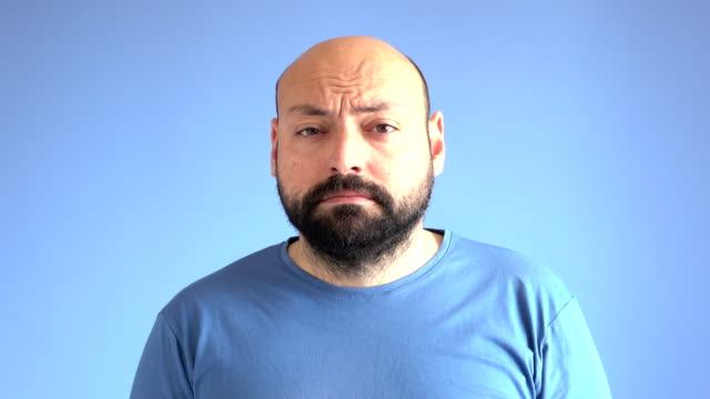 UHD Video Of Compilation Of Facial Expressions Of Adult Man On Blue Background