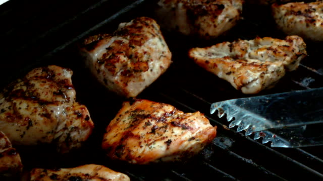 Video of cooking chicken on the grill-real slow motion