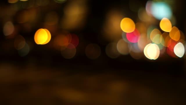 オレンジ色のトーンで多重都市夜景の 4 k 映像 - 焦点点の映像素材/bロール