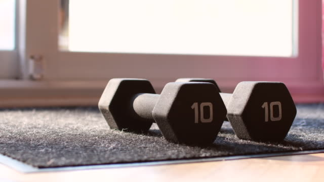 video of dumbbells on the floor in a kitchen. - number 10 stock videos & royalty-free footage