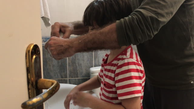 4k video of father shaving in bathroom while his son is imitating him - selimaksan stock videos & royalty-free footage