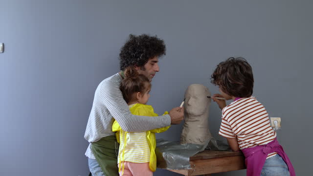 video of father, son and daughter making sculpture - selimaksan stock videos & royalty-free footage
