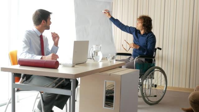 4k video of handicapped person on seminar - paraplegic stock videos & royalty-free footage