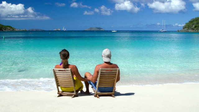 video of honeymoon couple sitting in chairs at a beach - caribbean sea stock videos & royalty-free footage