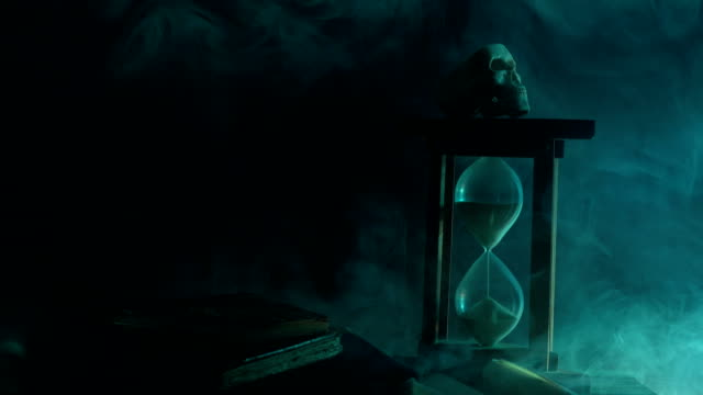 UHD Video Of Hourglass, Human Skeleton and Magic Book For Halloween