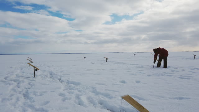 video of ice fishing in canada. - fishing industry stock videos & royalty-free footage