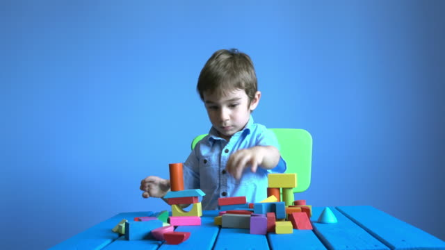 UHD Video Of Little Boy Playing With Multi colored Toys