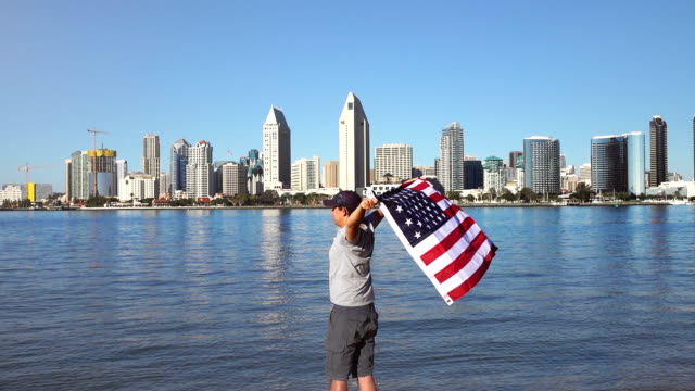 Video of man holding american flag in real slow motion