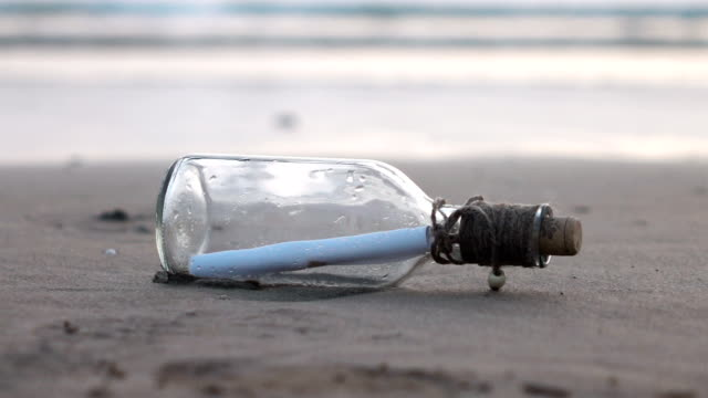 video of message in the bottle on the beach-slow motion - cork stopper stock videos & royalty-free footage
