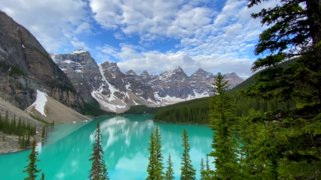 4k video of moraine lake at sunrise in june, banff national park, canada - banff stock videos & royalty-free footage