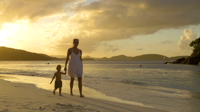 video of mother and child walking along the beach shoreline - st. john virgin islands stock videos & royalty-free footage