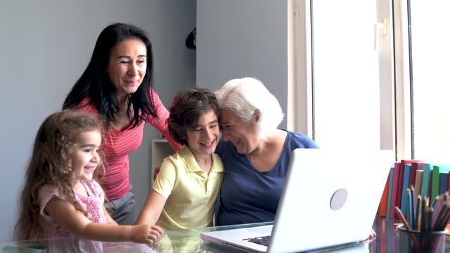 video of multi generation family using laptop computer for video call - 65 69 years stock videos & royalty-free footage